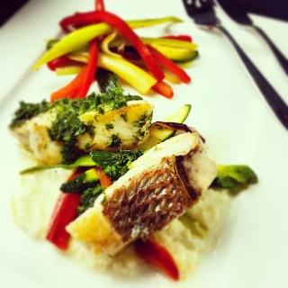 Herbed buttered red porgy with mashed cauliflower with lime and sautéed vegetables